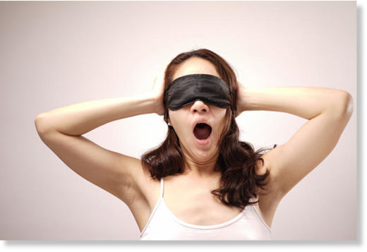 Blindfolded woman yawning