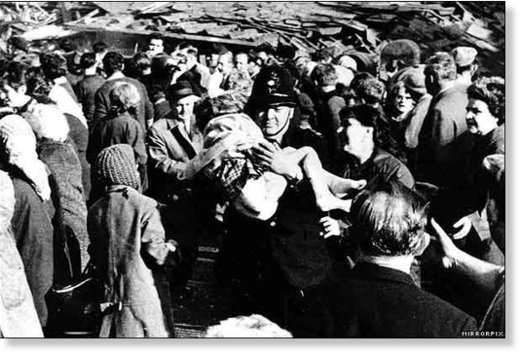 On Friday 21 October 1966, a coal tip collapsed sending thousands of tons of mud and colliery waste down Merthyr Mountain near Aberfan in South Wales, destroying a school and about 20 houses and killing 144 people. Susan Robertson, 8, was pulled alive fro