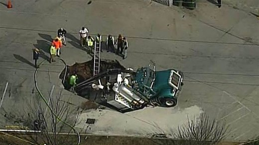 Excavation truck falls into sinkhole