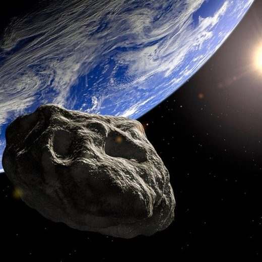 Artists rendering of an asteroid passing Earth