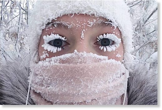 In this photo taken on Sunday, Jan. 14, 2018, Anastasia Gruzdeva poses for selfie as the Temperature dropped to about -50 degrees (-58 degrees Fahrenheit) in Yakutsk, Russia.