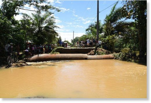 A section of the road washed away by floods in Maroanstetra District in north-eastern Madagascar following the landing of tropical storm Eliakim on the island nation on March 17, 2018.