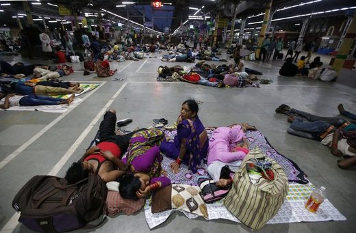 Stranded passengers in a railway station in Kolkata, India, in May after trains were canceled because of Cyclone Fani